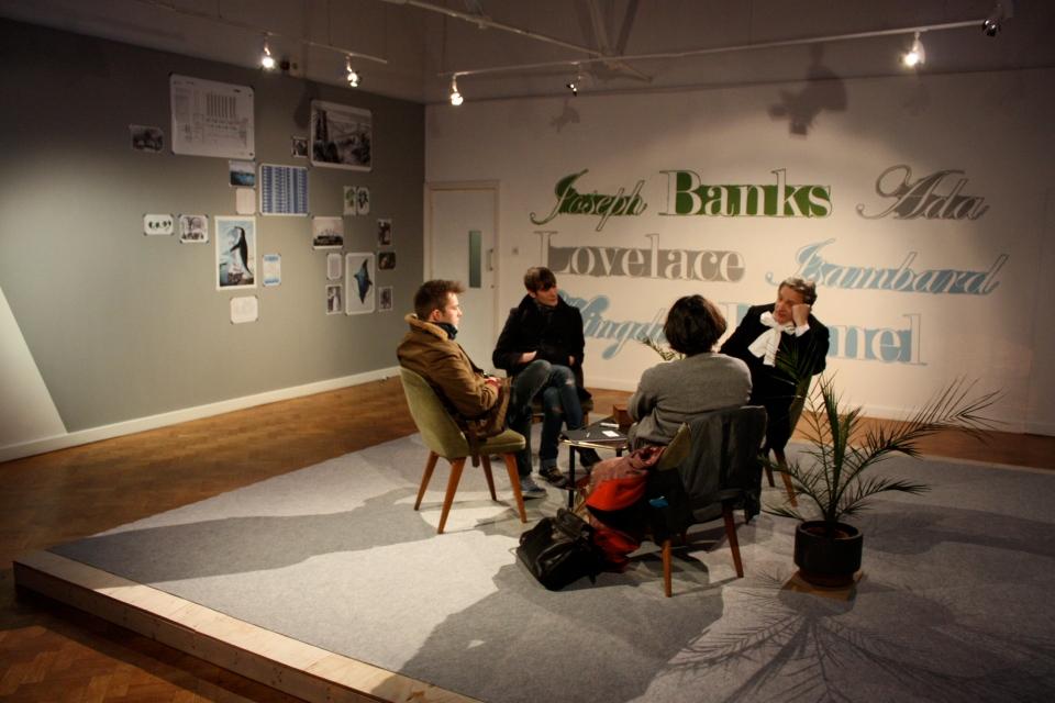 Participants talk with Brunel
